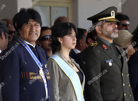 Stock Photo of Ahmad Vahidi, Maria Cecilia Chacon Bolivia's President Evo Morales, left, Iran's Defense Minister Gen. Ahmad Vahidi, right, and Bolivia's Defense Minister Maria Cecilia Chacon, center, look on during a military ceremony in Santa Cruz, Bolivia, . Vahidi, whose extradition is sought by neighboring Argentina for the 1994 bombing of a Jewish center, briefly visited Bolivia on Tuesday, raising tensions between the countries