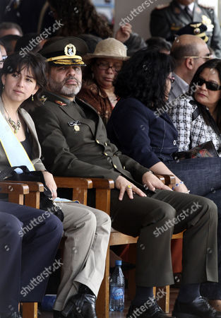 Ahmad Vahidi, Maria Cecilia Chacon Iran's Defense Minister Gen. Ahmad Vahidi, second from left, and Bolivia's Defense Minister Maria Cecilia Chacon, left, look on during a military ceremony in Santa Cruz, Bolivia, . Vahidi, whose extradition is sought by neighboring Argentina for the 1994 bombing of a Jewish center, briefly visited Bolivia on Tuesday, raising tensions between the countries