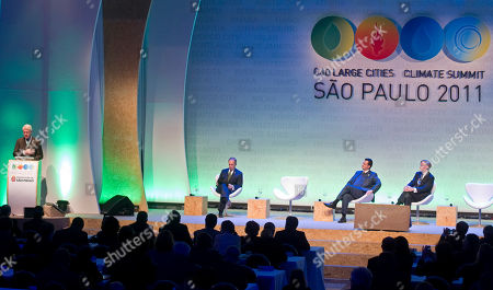 President Bill Clinton, Michael Bloomberg, Gilberto Kassab, Robert Zoelick Former President Bill Clinton delivers a speech, as Michael Bloomberg, Mayor of New York City, second left, Sao Paulo's Mayor Gilberto Kassab, and World Bank's President Robert Zoelick, right, listen during the C40 Large Cities Climate Summit in Sao Paulo, Brazil