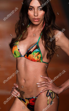 Lea T Brazilian transsexual model Lea T. wears a creation by Blue Man during the Fashion Rio Summer 2012 collection in Rio de Janeiro, Brazil