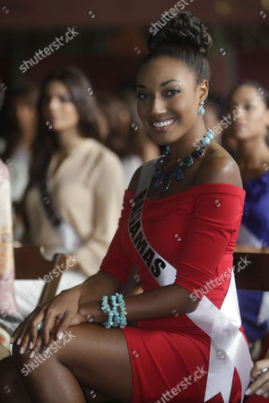 Miss Bahamas Anastagia Pierre looks at the camera during a visit to a samba school in Sao Paulo, Brazil, . The 60th anniversary of the Miss Universe pageant is scheduled for Sept. 12 from Sao Paulo. Last year's winner was Mexico's Jimena Navarrete