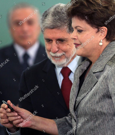 Stock Picture of Dilma Rousseff, Celso Amorim Brazil's President Dilma Rousseff, right, hands a pen to Brazil's new Defense Minister Celso Amorim during his swearing in ceremony at the Planalto palace, in Brasilia, Brazil, . Brazilian former Defense Minister Nelson Jobim resigned late Thursday after a newspaper said he had criticized two Cabinet colleagues, becoming the third Cabinet member to quit since the administration took office Jan. 1