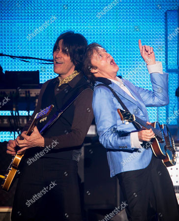 Paul McCartney, Rusty Anderson Paul McCartney, right, performs with guitarist Rusty Anderson in Rio de Janeiro, Brazil