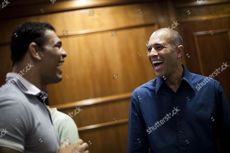Stock Image of Royce Gracie, Minotauro Nogueira Brazilian Mixed Martial Arts (MMA) legend Royce Gracie, right, jokes with Brazilian MMA fighter Minotauro Nogueira before the start of a news conference in Rio de Janeiro, Brazil, . The MMA organization, the Ultimate Fighting Championship (UFC), is returning home to Brazil for UFC 134 on Aug. 28. The Brazilians helped bring mixed martial arts to life in the early 1990s, and they remain some of the sport's top fighters