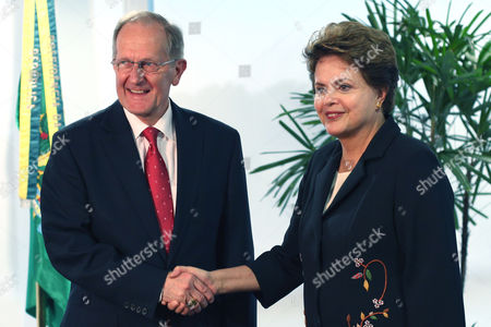Stock Image of Dilma Rousseff, Joseph Deiss UN General Assembly President Joseph Deiss, left, shakes hands with Brazil's President Dilma Rousseff, during a meeting at the Planalto Palace in Brasilia, Brazil, . Deiss is on a one-day visit to Brazil