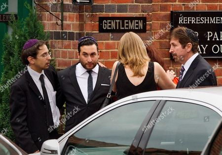 Alex Winehouse British singer Amy Winehouse's brother Alex, second from left, is consoled by unidentified people as he arrives at Golders Green Crematorium for the funeral ceremony of his sister, north London, . Winehouse, who had battled alcohol and drug addiction, was found dead Saturday at her London home. She was 27