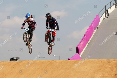 Amanda Carr, Manon Valentino U.S.'s Amanda Carr, left, and France's Manon Valentino practice during the BMX Supercross World Cup at the Olympic Park's BMX Track in London, . The course will host the London 2012 Olympic BMX competition next year