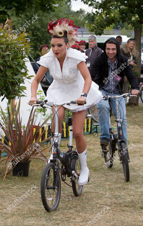 Stock Photo of Laura Steel rides a bike backstage after she performs at the Isle of Wight music festival