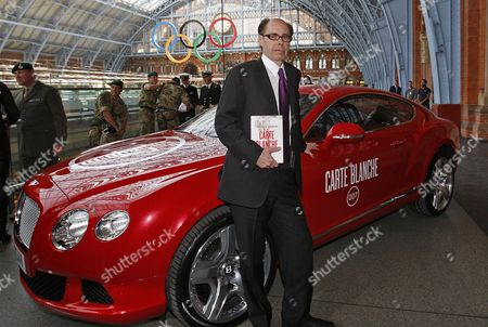U.S. thriller writer Jeffery Deaver poses for photographers by a special Bentley Continental GT during a photo call for his new James Bond novel 'Carte Blanche' at St. Pancras International in London, . 'Carte Blanche' is due to be published by Hodder & Stoughton on the following day, Thursday, May 26