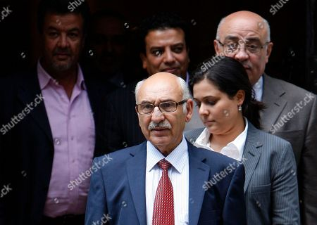 Libyan Embassy envoy Mahmud Nacua, foreground, leaves 10 Downing Street with unidentified aides, following his meeting with Britain's Prime Minister David Cameron, in London