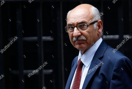 Libyan Embassy envoy Mahmud Nacua, foreground, leaves 10 Downing Street following his meeting with Britain's Prime Minister David Cameron, in London