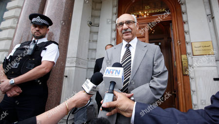 Stock Photo of Mahmoud Nacua The new Libyan Charge d'Affairs to the United Kingdom Mahmud Nacua speaks to the media outside the embassy in London, Monday, Aug., 22, 2011. Nacua called for the end of NATO military action against Libya as the NTC begins to take charge, and he believes that Col. Gadaffi is still at large in Libya