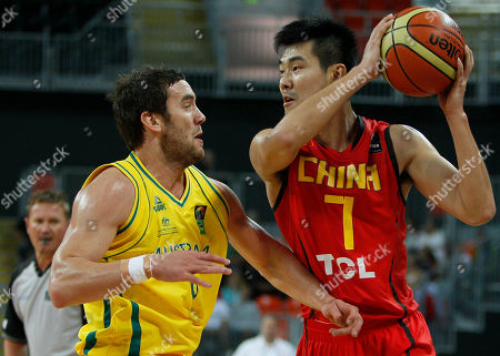 Adam Gibson, Shipeng Wang China's Shipeng Wang right, runs with the ball against Australia's Adam Gibson during the London International Basketball Invitational, a test event at the Basketball arena at the Olympic Park in east London Tuesday, Aug., 16, 2011. The London 2012 Olympic organising committee are holding a series of test events in the run up to the games