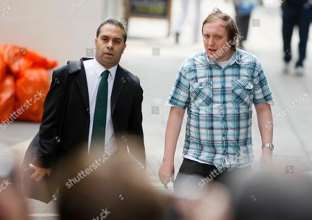 Jonathan May-Bowles, right, arrives at Westminster Magistrates Court to answer charges of a public order offence in London, . My-Bowles has been accused of throwing a plate of shaving foam at media tycoon Rupert Murdoch as he gave evidence to a British Parliamentary select committee on July 20. Man at left is unidentified