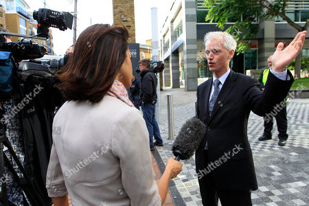 David Wooding News of the World political editor, David Wooding, right, speaks to the media outside the headquarter of News International, the publisher of News of the World newspaper, in London, . Writing the obituary for their own newspaper, News of the World's journalists prepared their final edition Saturday as Britain's media establishment reeled from the expanding phone-hacking scandal that brought down the muckraking tabloid after 168 years