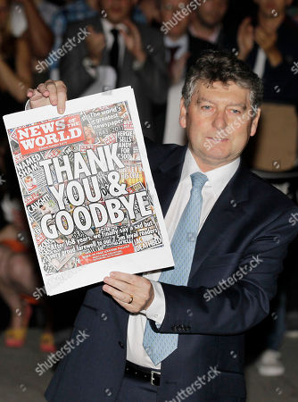 Colin Myler FILE-In this photo News of the World tabloid newspaper Editor, Colin Myler poses with a front page of the last edition as he leads his staff out of the headquarter of News International, the publisher of News of the World newspaper, in London. Four former executives at Rupert Murdoch's News International are testifying before British lawmakers on the country's tabloid phone hacking scandal
