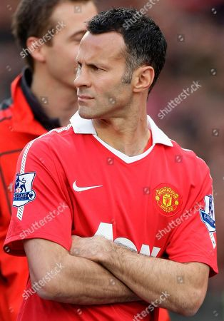 In this image Manchester United's Ryan Giggs is seen before receiving his English Premier League winning medal following his team's 4-2 win over Blackpool in their English Premier League soccer match at Old Trafford Stadium, Manchester, England. Giggs had been granted a privacy injunction preventing media from publishing his identity or allegations that he'd had an affair with a reality television contestant. However, British lawmaker John Hemming MP identified Giggs in Parliament on Monday May 23, 2011. Members of Parliament benefit from absolute immunity, meaning that they have free rein to say what they wish and can shrug off the threat of contempt of court. (AP Photo/Jon Super) NO INTERNET/MOBILE USAGE WITHOUT FOOTBALL ASSOCIATION PREMIER LEAGUE