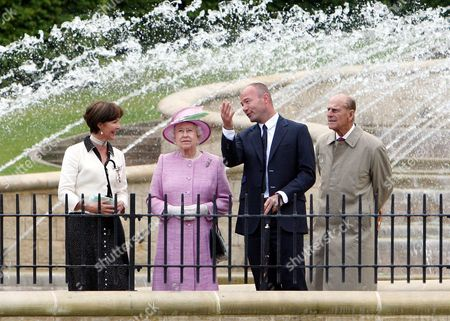 Britain's Queen Elizabeth II, second left, Duchess of Northumberland, left, Alan Shearer, second right, and Prince Philip, Duke of Edinburgh, right, at Alnwick Gardens in Alnwick, England, The Queen and Prince Philip are meeting with groups of volunteers and carers who have been invited to Alnwick to celebrate and recognise their work