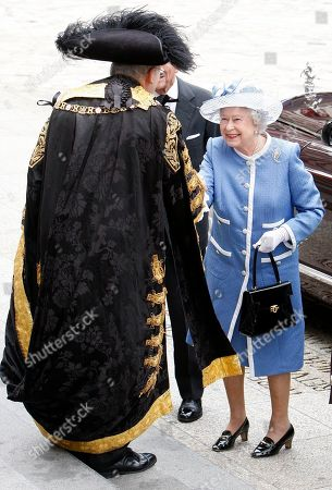 Britain's Queen Elizabeth II, right, is greeted by Lord Mayor Michael Bear as she arrives at St Paul's Cathedral in London, to attend a service to celebrate its Tercentenary