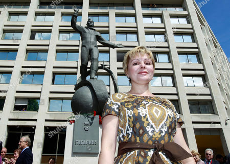 Elena Gagarina Elena Gagarina, director of the Kremlin Museums in Moscow, and daughter of Yuri Gagarin, the first man in space, poses in front of a newly-unveiled statue of her father, outside the headquarters of the British Council, in central London, . A gift from the Russian Space Agency (Roscosmos) to the British Council, the statue shows Gagarin standing on a globe in his space suit, and it will be installed at this location for a period of 12 months to mark the 50th anniversary of the first manned space flight