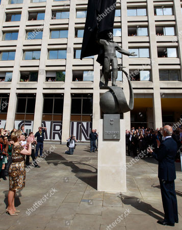 Stock Photo of Elena Gagarina, left, director of the Kremlin Museums in Moscow and daughter of Yuri Gagarin, the first man in space, and Britain's Prince Michael of Kent, right, unveil a statue of Gagarin outside the headquarters of the British Council, in central London, . A gift from the Russian Space Agency (Roscosmos) to the British Council, the statue shows Gagarin standing on a globe in his space suit, and it will be installed at this location for a period of 12 months to mark the 50th anniversary of the first manned space flight