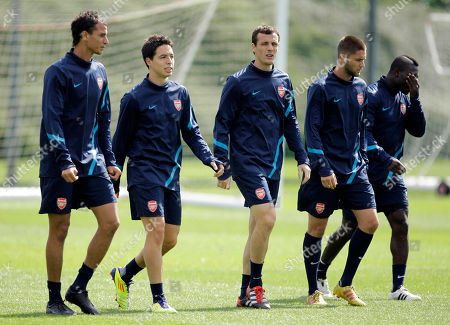 Arsenal players from left, Marouane Chamakh, Samir Nasri, Sebastien Squillaci, Henri Lansbury and Emmanuel Frimpong take part in a training session at their training facilities in London Colney, London Colney, England