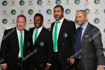 Eric Cantona, Pele, Paul Kemsley, Karl Fowler Soccer legends, New York Cosmos' Director of Soccer Eric Cantona, center right, Honorary President Pele, center left, CEO Paul Kemsley, left, and Opus Media's CEO Karl Fowler pose during the announcement of the New York Cosmos Opus in London, . The New York Cosmos Opus is the definitive publication on one of the world's most glamorous soccer franchises. New York Cosmos is due to play Manchester United in a Paul Scholes testimonial match at Old Trafford on Friday, the first U.S. team to play at the stadium