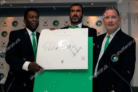 Eric Cantona, Pele, Paul Kemsley Soccer legends, New York Cosmos' Director of Soccer Eric Cantona, center, Honorary President Pele, left, and CEO Paul Kemsley pose with the signed copy of the signature sheet during the announcement of the New York Cosmos Opus in London, . The New York Cosmos Opus is the definitive publication on one of the world's most glamorous soccer franchises. New York Cosmos is due to play Manchester United in a Paul Scholes testimonial match at Old Trafford on Friday, the first U.S. team to play at the stadium