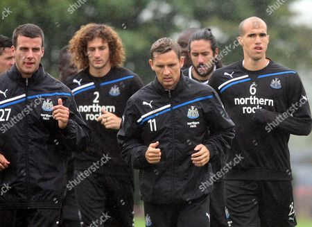 Newcastle United's Steven Taylor, left, Peter Lovenkrands, center, and Gabriel Obertan, right, are seen during a training session at the club's training ground in Benton, Newcastle, England, . Newcastle will play Arsenal in a Premier League match on Saturday