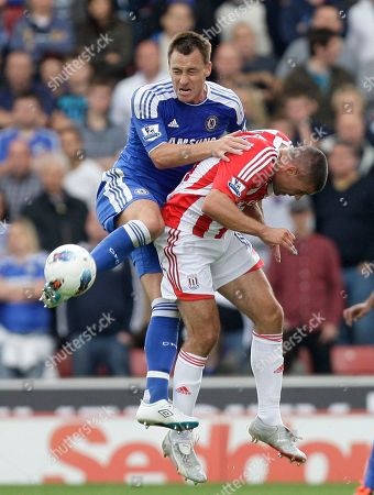 Stoke's Jonathan Walters, right, fights for the ball against Chelsea's John Terry during their English Premier League soccer match at the Britannia Stadium, Stoke, England