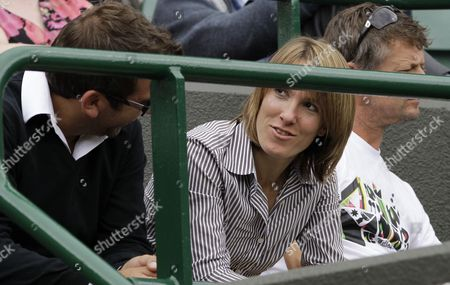 Belgium's former tennis champion Justine Henin watches the girls' singles final at the All England Lawn Tennis Championships at Wimbledon