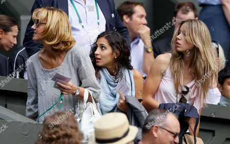 Spain's Rafael Nadal's mother Ana Maria Parera, left, his girfriend Maria Francisca Perello, center, and sister María Isabel take their seats prior to his semifinal match against Britain's Andy Murray at the All England Lawn Tennis Championships at Wimbledon
