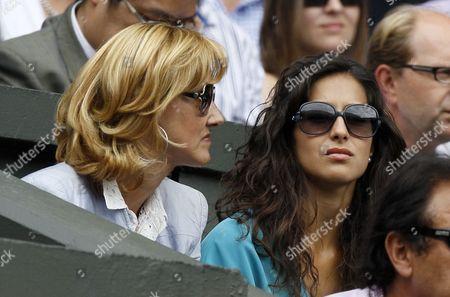 Spain's Rafael Nadal's mother Ana Maria Parera, left, and his girfriend Maria Francisca Perello watch the men's singles final between Rafael Nadal and Serbia's Novak Djokovic at the All England Lawn Tennis Championships at Wimbledon