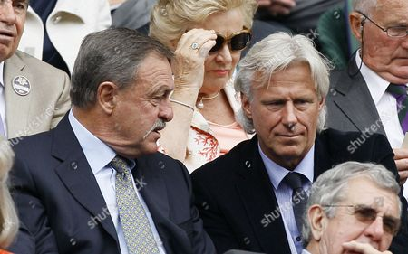 Former Wimbledon champions Bjorn Borg, right, and Australia's John Newcombe watch the men's singles final between Spain's Rafael Nadal and Serbia's Novak Djokovic at the All England Lawn Tennis Championships at Wimbledon