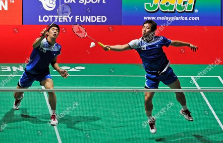 Yun Cai, Haifeng Fu Korea's Jae Sung Jung, right, and Yong Dae Lee return a shot to China's Yun Cai and Haifeng Fu during their match at the World Badminton Championships at Wembley Arena, London, . The championships are an unofficial testing event for the London Olympics