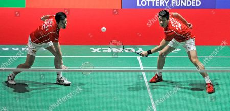 Yun Cai, Haifeng Fu China's Yun Cai and Haifeng Fu, right, return a shot to Korea's Jae Sung Jung, and Yong Dae Lee during their match at the World Badminton Championships at Wembley Arena, London, . The championships are an unofficial testing event for the London Olympics