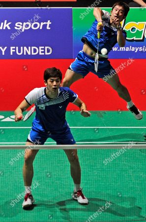 Jae Sung Jung, Yong Dae Lee Korea's Jae Sung Jung, right, and Yong Dae Lee return a shot to China's Yun Cai and Haifeng Fu during their match at the World Badminton Championships at Wembley Arena, London, . The championships are an unofficial testing event for the London Olympics