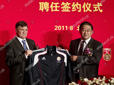 Jose Antonio Camacho, Wei Di Former Spain coach Jose Antonio Camacho, left, and Wei Di, Chairman of China Football Association pose with Camacho's jersey after a signing ceremony in Beijing, China, . Camacho will lead China's national team in the qualification run-up to the Brazil World Cup soccer tournament