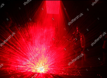 "Visitors walk inside a laser light installation art titled ""V"" by Chinese artiste Li Hui displayed at a art gallery in Beijing, China"