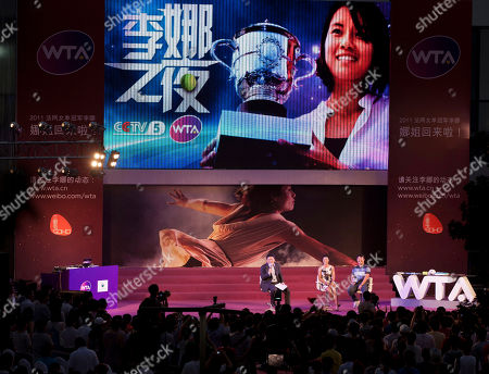 Li Na, Jiang Shan Chinese tennis player Li Na, center, accompanied by her husband Jiang Shan, right, on a stage meets her fans at an event organized by Women Tennis Association (WTA) in Beijing, China, . Li was doing her best to keep a low profile in China, despite returning home to a hero's welcome after securing the country's first Grand Slam title at the French Open
