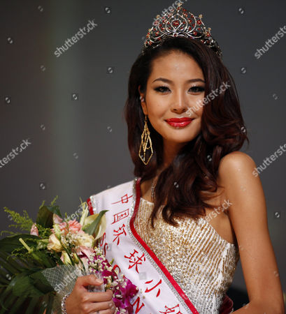 Luo Zilin smiles after winning the 2011 Miss Universe China pageant in Beijing, China