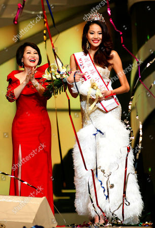 Luo Zilin Luo Zilin, right, smiles after winning the 2011 Miss Universe China pageant in Beijing, China