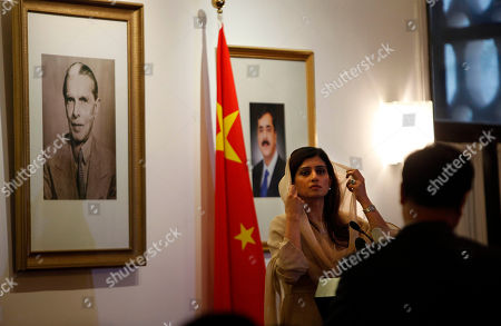 Hina Rabbani Khar Pakistan's Foreign Minister Hina Rabbani Khar speaks near a portrait of Pakistan's Prime Minister Yusuf Raza Gilani at center and portrait of Pakistan's founding father Muhammad Ali Jinnah, left, during a briefing at the Pakistan Embassy in Beijing, China