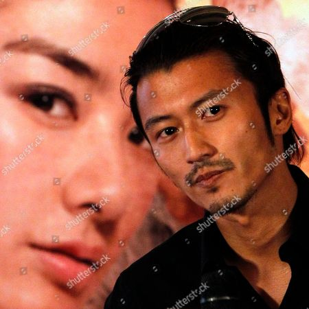 "Nicholas Tse Hong Kong actor Nicholas Tse reacts as he confirms marital problems with Hong Kong actress Cecilia Cheung after weeks of reports in the Chinese media during the gala for the movie ""Treasure Inn"" in Beijing, China"