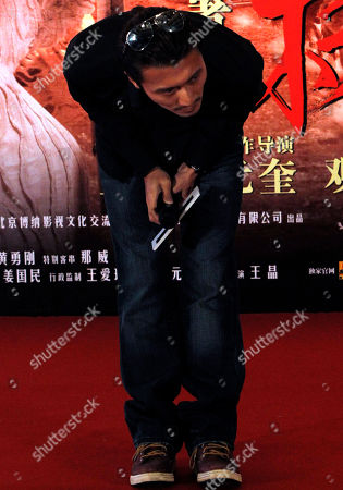 "Nicholas Tse Hong Kong actor Nicholas Tse bows after confirming marital problems with Hong Kong actress Cecilia Cheung after weeks of reports in the Chinese media during the gala for the movie ""Treasure Inn"" in Beijing, China"