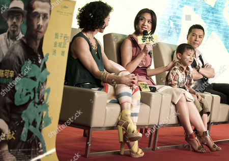 """Tang Wei, Donnie Yen, Kara Hui, Li Jiamin Chinese actress Tang Wei, center, speaks as Hong Kong actor Donnie Yen, right, Chinese child actor Li Jiamin, second from right, and Hong Kong actress Kara Hui, left, listen on during a news conference of their latest movie """"Wu Xia"""" in Beijing, China"""