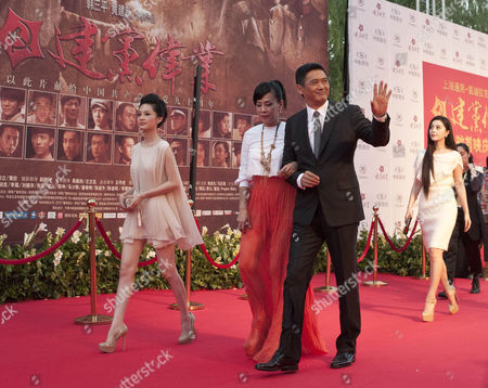 "Chow Yun-fat, Jasmine Chow, Li Qin, Fang Bingbing Hong Kong actor Chow Yun-fat and his wife Jasmine Chow, center, are followed by Chinese actresses Li Qin, far left, and Fan Bingbing as they arrive for the movie premiere of ""Beginning of the Great Revival"" in Beijing, China, . Chinese movie stars have gathered to launch the blockbuster propaganda movie celebrating the 90th anniversary of the Chinese Communist Party"
