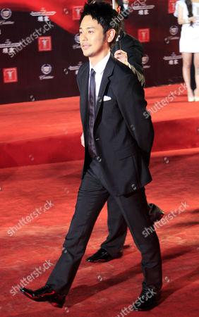 Satoshi Tsumabuki Japanese actor Satoshi Tsumabuki walks on the red carpet prior to the opening ceremony of the Shanghai International Film Festival at Shanghai Grand Theater in Shanghai. China