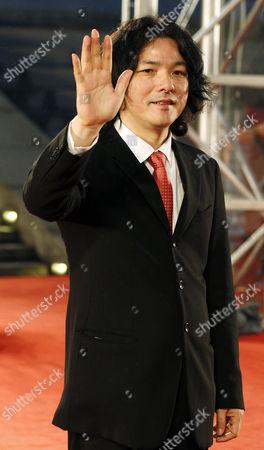 Shunji Iwai Japanese film director Shunji Iwai waves on the red carpet prior to the closing ceremony of the Shanghai International Film Festival at Shanghai Grand Theater in Shanghai. China