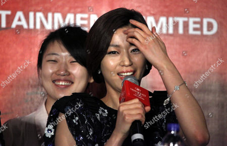 """Gianna Jun South Korean actress Gianna Jun answers a question from a journalist during a press conference of a film """"Snow Flower and the Secret Fan"""" as part of the 14th Shanghai International Film Festival Sunday in Shanghai, China"""